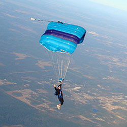 Person skydiving with parachute open